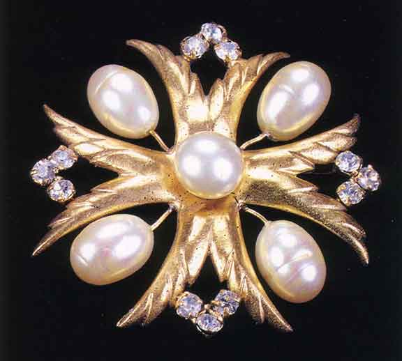 Figure 9 - 1920s Faux Pearl Maltese Cross Brooch.  From <q>Jewelry by Chanel</q> by Mauries.