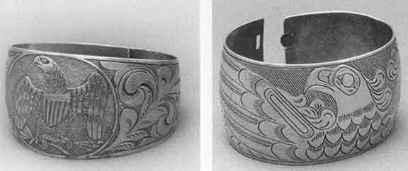 Two 19th century European-influenced silver bracelets.  The bracelet on the left is Haida, and earlier.   The bracelet on the right is believed to be Tlingit and is a little later.  It reflects more Indian styling.  From 'The Box of Daylight'