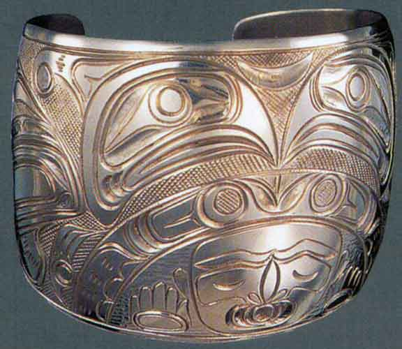 Thunderbirds and Tsonokwa engraved silver bracelet by Lloyd Wadhams, 1965.  Kwakwaka'wakw.  From
