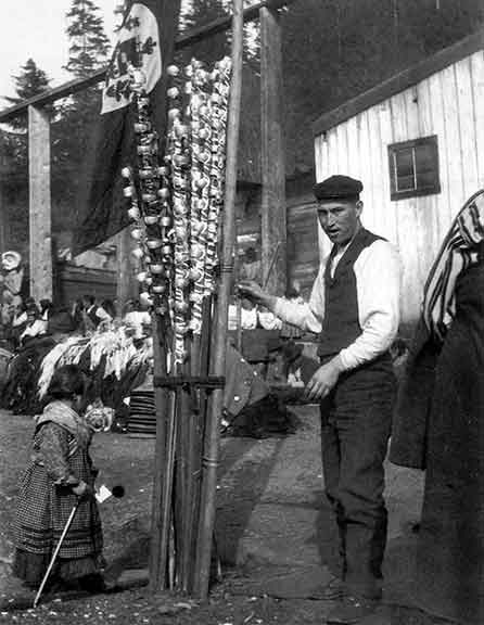 Bracelets stacked for potlatch distribution at Alert Bay in late 1800s.  From